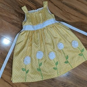 Yellow dress with white polka dots and flowers